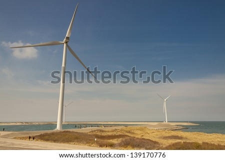 Big white windmills farm near Brouwers-dam in Netherlands. - stock photo