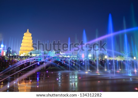 big wild goose pagoda with beautiful fountains at night ,Xian, China. - stock photo