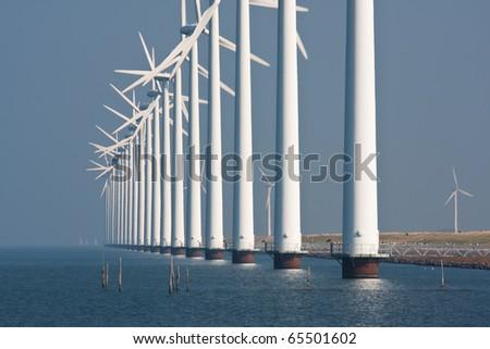 Big windturbines along the Dutch coast - stock photo