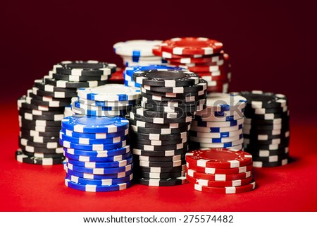 big winner in poker. chips on red cloth closeup