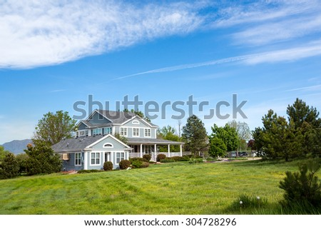 Big wooden house surrounded by nice nature - stock photo