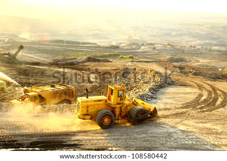 big yellow mining truck at worksite - stock photo