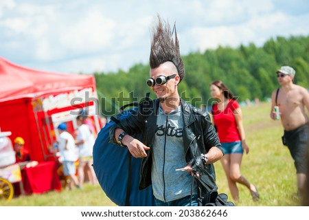 "BIG ZAVIDOVO, RUSSIA - JULY 4: People attend open-air rock festival ""Nashestvie"" on July 4, 2014 in Big Zavidovo, Russia. ""Nashestvie"" is the biggest rock festival in Russia, more than 200000 visitors"