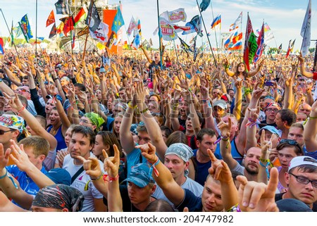 "BIG ZAVIDOVO, RUSSIA - JULY 5: People cheering at open-air rock festival ""Nashestvie"" on July 5, 2014 in Big Zavidovo, Russia. ""Nashestvie"" is the biggest rock festival in Russia, more 200000 visitors"