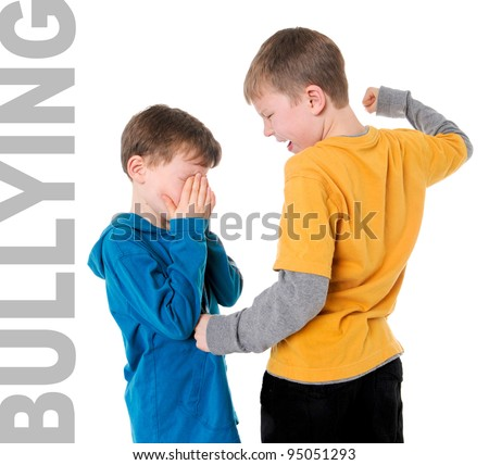 Bigger Boy Bullying Smaller Boy - stock photo