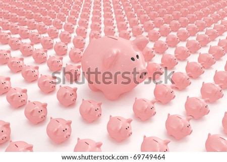 Bigger piggy bank standing out from others - stock photo