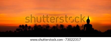 Biggest buddha statue in sunset background - stock photo