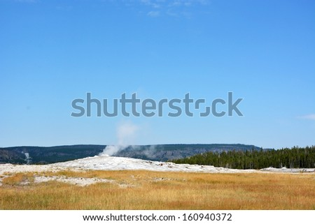 Biggest geyser in Yellowstone national park- Old Faithful geyser - stock photo