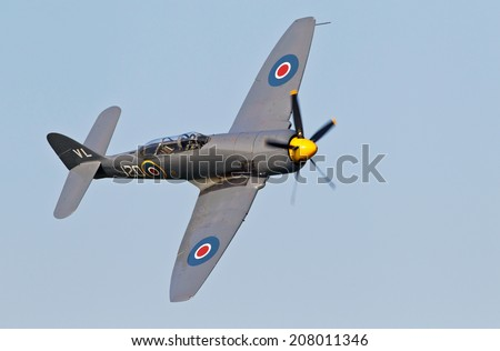 BIGGLESWADE, UK - JULY 6: A Hawker Sea Fury of the Royal Naval Historic Flight approaches the Old Warden airfield before giving an aerial display to the public on July 6, 2013 in Biggleswade - stock photo