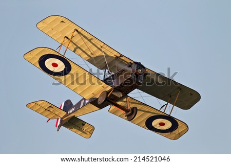 BIGGLESWADE, UK - JULY 6: A WW1 Se5a biplane flies around the outside of the airfield before landing at the end of a flying display on July 6, 2013 in Biggleswade - stock photo