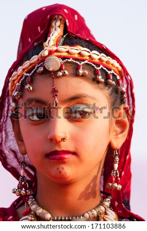 BIKANER, INDIA - January 10: An unidentified girl participates in Camel Festival on January 10, 2009 in Bikaner, Rajastan, India.  The festival takes place in January in Bikaner every year.