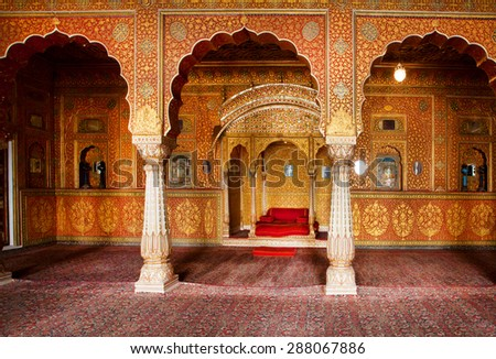 BIKANER, INDIA - MAR 4: Maharaja's resting room with arches in gold patterns inside 16th century Junagarh Fort on March 4, 2015. The 5.28 hectares large Fort precinct is studded with palaces, temples - stock photo