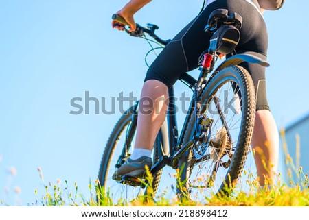Bike and foot athlete closeup - stock photo