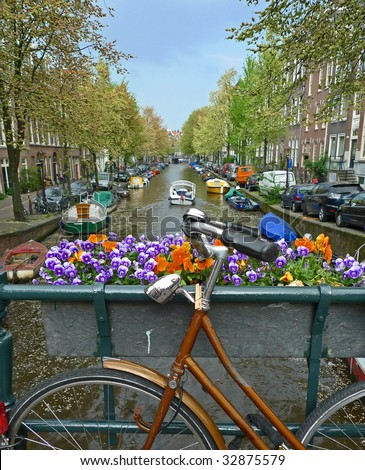 Bike flowers and canal. Amsterdam, Netherlands - stock photo