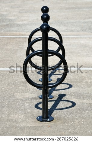 Bike holder stand at park area. - stock photo