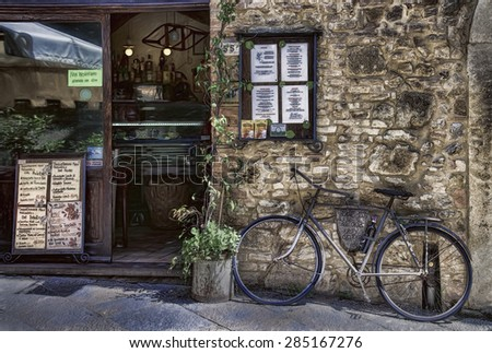 Bike in Front of a Restaurant in Volterra, Italy - stock photo