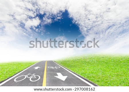 Bike lane and Grass patch on the sky background. - stock photo