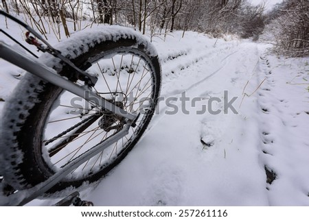 bike off the trail buried in snow in winter scenery - stock photo - stock photo