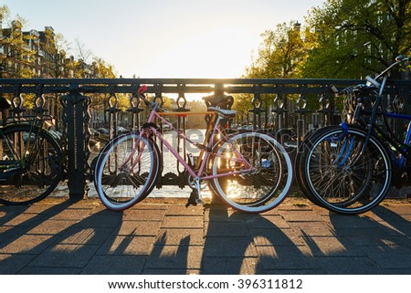 bike on amsterdam street in city - stock photo