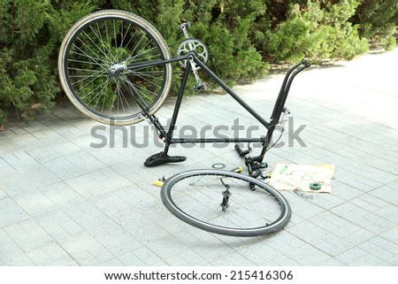 Bike parts in restoration process, outdoors  - stock photo