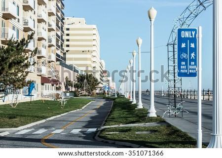 Bike path sign at the Virginia Beach oceanfront boardwalk bike path. - stock photo