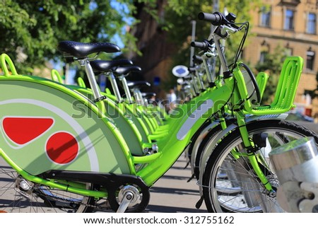 Bike rental service/Many bikes in a city context - stock photo