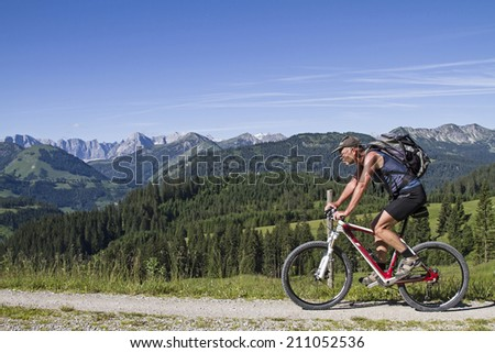 Bike ride over the saddle between Juifen and Demmeljoch  - stock photo