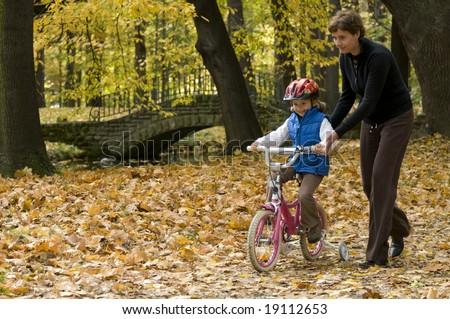 Bike riding lesson - stock photo
