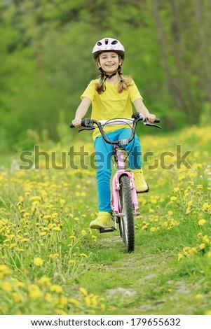 Bike riding - young girl on bike - stock photo