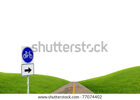 Bike sign with bicycle path and green hill - stock photo