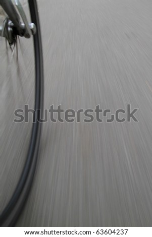 bike wheels in motion on street - stock photo