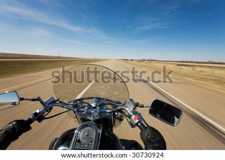 Biker enjoying a ride on the trans canada highway on a sunny day - stock photo