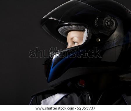 Biker girl wearing her helmet - stock photo