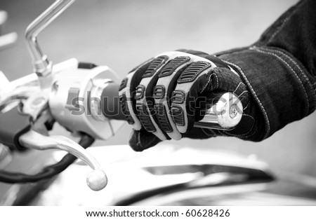 Biker hand rests on the steering wheel motorcycle ( black white ) - stock photo