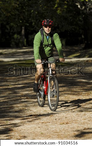 Biker in action on a park - stock photo