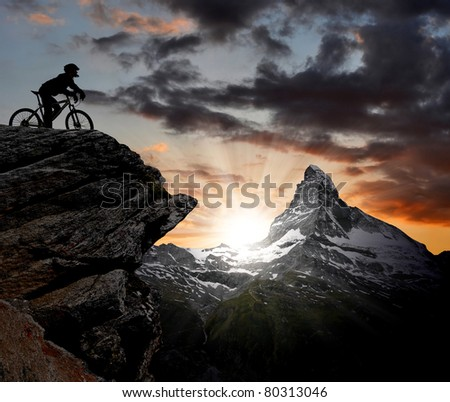 biker in the Swiss Alps - stock photo