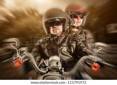 Biker man and girl sits on a bike - stock photo