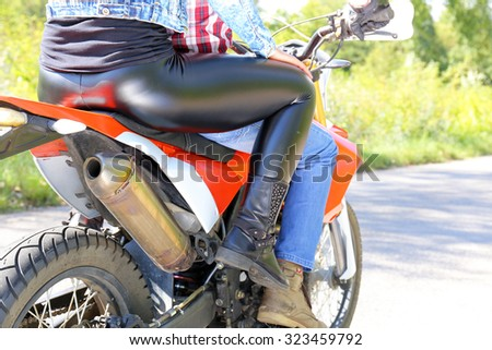 Biker Man and woman  riding on motorcycle