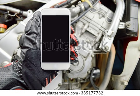 biker man calling a mechanic with the phone - stock photo