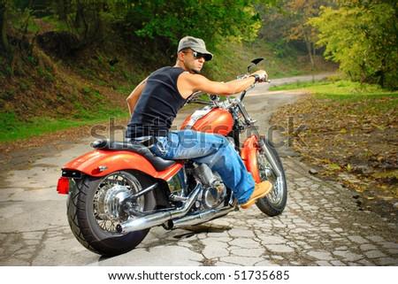 Biker on a chopper - stock photo