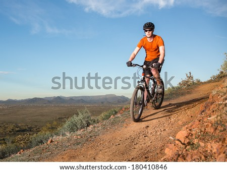 Biker on Desert Trail - stock photo