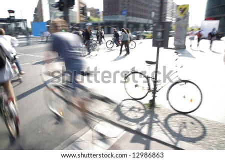 biker on downtown pedestrian overpath - stock photo