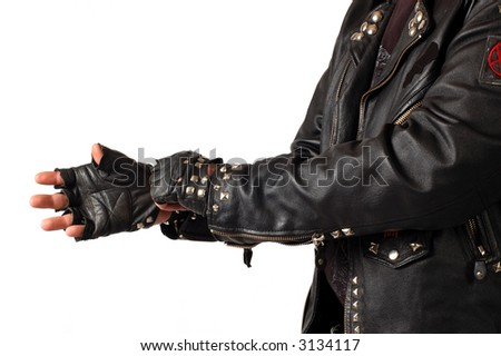 biker puts on a glove isolated on white