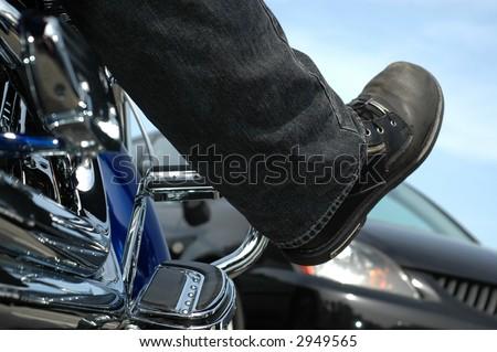 Biker stuck in traffic on the freeway - stock photo