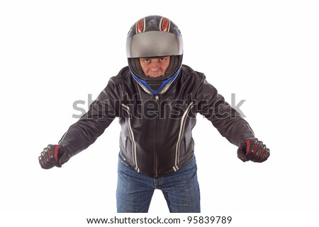 Biker with the helmet looking sharp in driving pose - stock photo