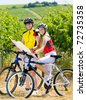 bikers holding a map in vineyard, Czech Republic - stock photo