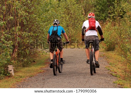 bikers on the trail - stock photo