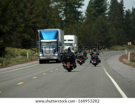 Bikers & trucks - motorcycles & leather on forested highway			Central Oregon