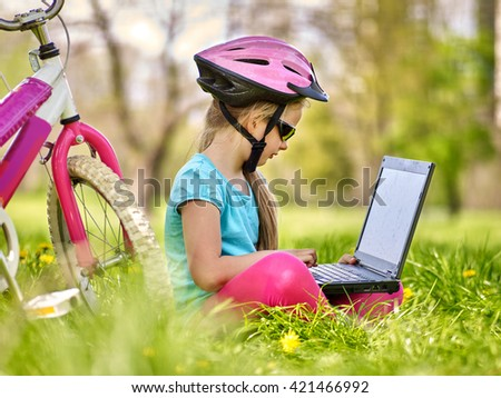 Bikes cycling girl. Girl rides bicycle. Girl in cycling sitting near bicycle and watch pc tablet. Cycling is good for health. Cyclist looking for road. Outdoor recreation with pc tablet. - stock photo