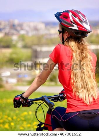 Bikes cycling girl wearing helmet. - stock photo